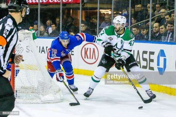 Dallas Stars Right Wing Alexander Radulov looks to pass as New York Rangers Defenseman Brady Skjei defends during the Dallas Stars and New York...
