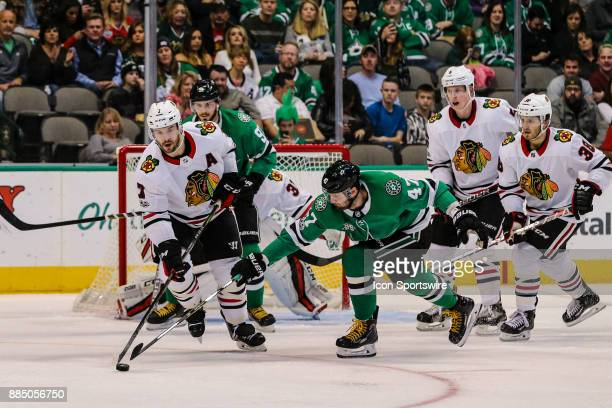 Dallas Stars right wing Alexander Radulov poke checks the puck from Chicago Blackhawks defenseman Duncan Keith during the game between the Dallas...