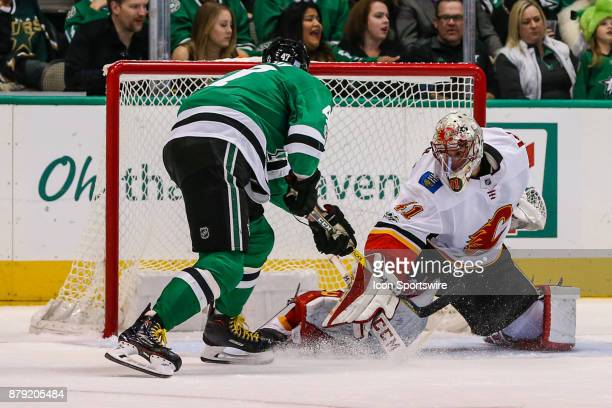 Dallas Stars right wing Alexander Radulov pokes the puck past Calgary Flames goalie Mike Smith for a goal during the game between the Dallas Stars...