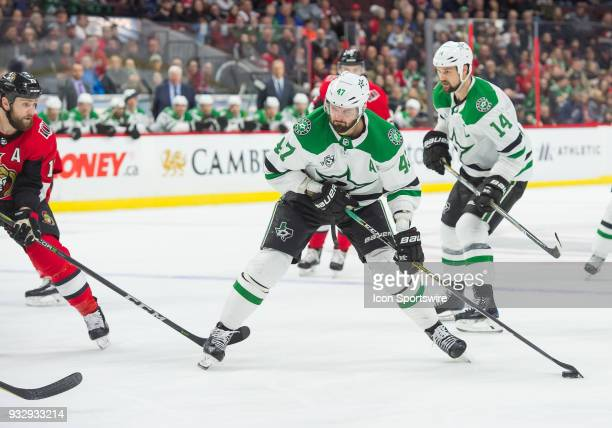 Dallas Stars Right Wing Alexander Radulov prepares to shoot the puck at goal as Ottawa Senators Center Zack Smith attempts to defend during the first...