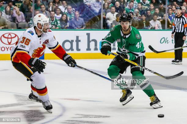 Dallas Stars right wing Alexander Radulov tries to pass the puck past Calgary Flames right wing Troy Brouwer during the game between the Dallas Stars...