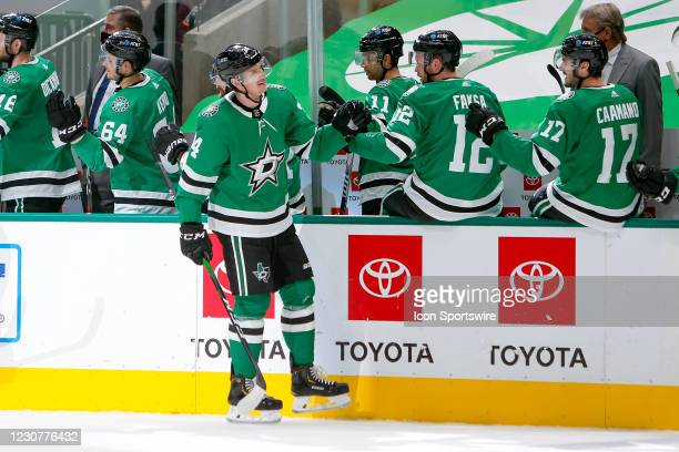 Dallas Stars Right Wing Denis Gurianov slaps gloves after scoring a power play goal during the first period between the Nashville Predators and...