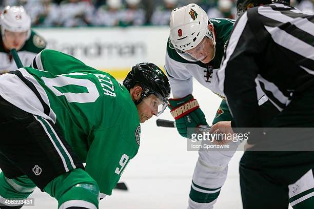 Dallas Stars Right Wing Jason Spezza and Minnesota Wild Center Mikko Koivu prepare for a face-off during the NHL game between the Minnesota Wild and...