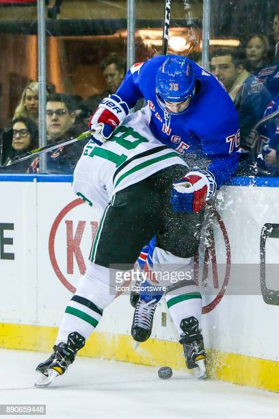 Dallas Stars Right Wing Tyler Pitlick checks New York Rangers Defenseman Brady Skjei against boards as puck slides free during the Dallas Stars and...