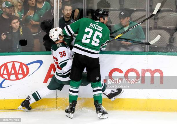 Dallas Stars right winger Brett Ritchie makes a big hit on Minnesota Wild defenseman Nick Seeler during the game between the Minnesota Wild and the...