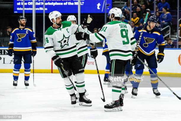Dallas Stars' Tyler Seguin right is congratulated after he scores a goal by Jamie Benn during the first period of an NHL hockey game between the St...