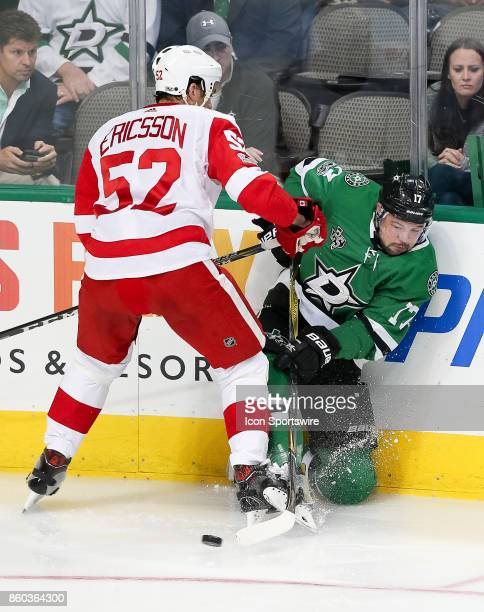 Dallas Stars Winger Devin Shore and Detroit Red Wings Defenceman Jonathan Ericsson battle for a puck during the NHL game between the Detroit Red...