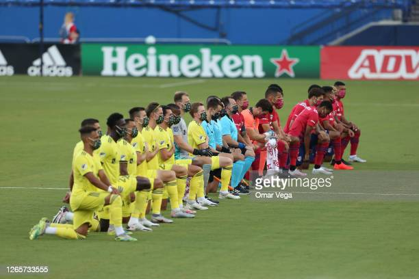 Dallas Team and Nashville SC Team get to their knees during the national anthem prior the game game between FC Dallas and Nashville SC as part of the...