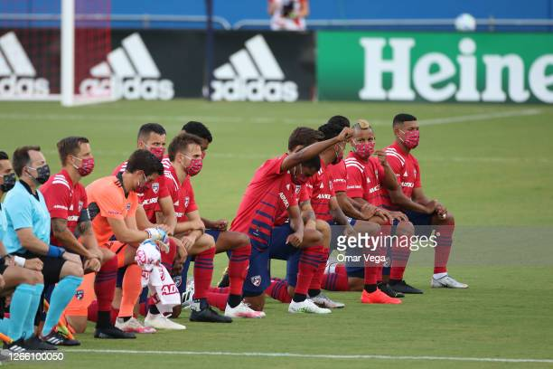 Dallas Team get to their knees during the national anthem prior the game game between FC Dallas and Nashville SC as part of the Major League Soccer...