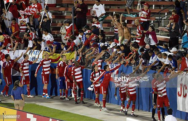 Dallas team members celebrate with their fans after beating the Chicago Fire 30 at Pizza Hut Park on October 2 2010 in Frisco Texas