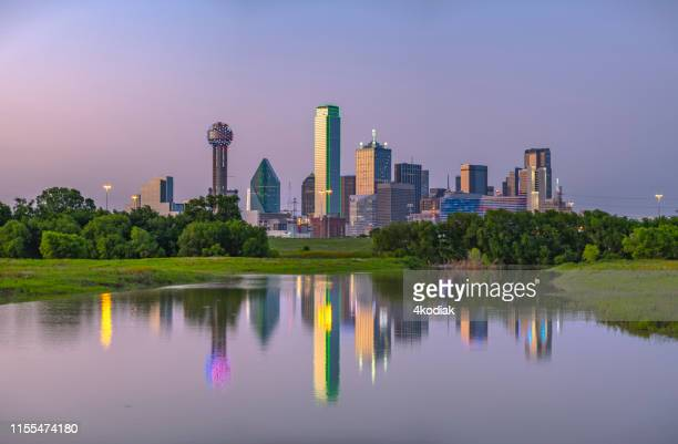 dallas texas evening skyline with trinity river - trinity river texas stock pictures, royalty-free photos & images