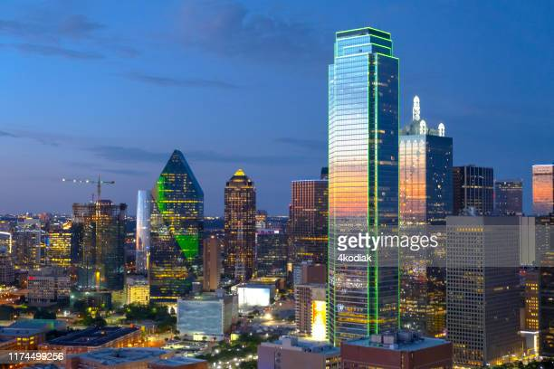 dallas texas skyline at twilight - dallas stock pictures, royalty-free photos & images