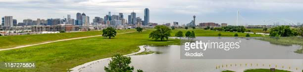 dallas texas with flooded trinity river after heavy rain - trinity river texas stock pictures, royalty-free photos & images