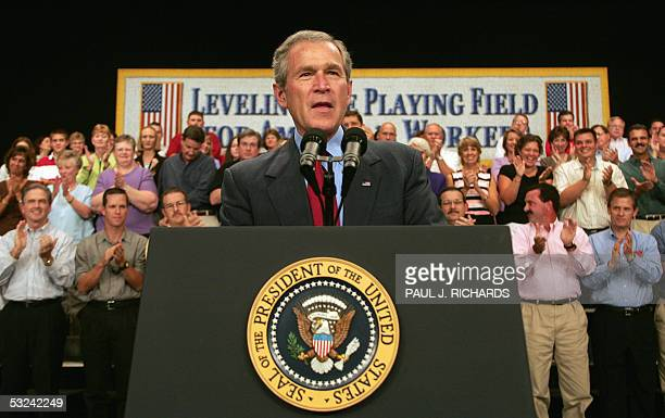 US President George W Bush greets the guests on stage shortly before delivering remarks on CAFTADR inside the Myers Center at Gaston College 15 July...