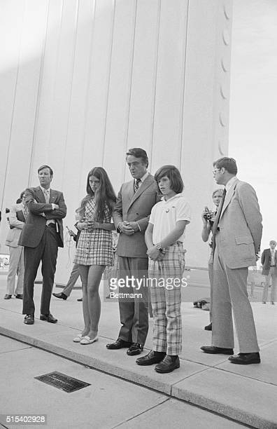 Dallas: Vice Presidential Candidate Sargent Shriver and his two children Tim and Maria lower their heads in silent prayer in the John F. Kennedy...