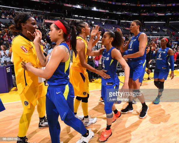 Dallas Wings and Los Angeles Sparks high five after the Los Angeles Sparks win the game on June 26 2018 at STAPLES Center in Los Angeles California...