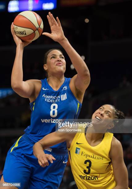 Dallas Wings center Elizabeth Cambage drives to the basket against Los Angeles Sparks forward Candace Parker during the game between the Dallas Wings...