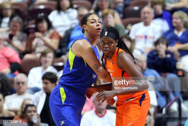 Dallas Wings center Liz Cambage and Connecticut Sun forward Jonquel Jones in action during a WNBA game between Dallas Wings and Connecticut Sun on...
