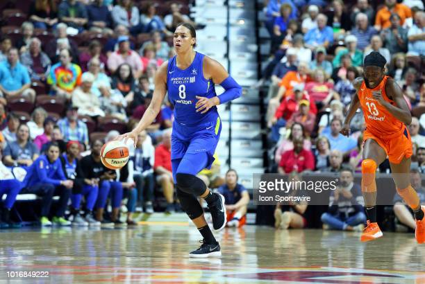 Dallas Wings center Liz Cambage fast breaks during a WNBA game between Dallas Wings and Connecticut Sun on August 14 at Mohegan Sun Arena in...