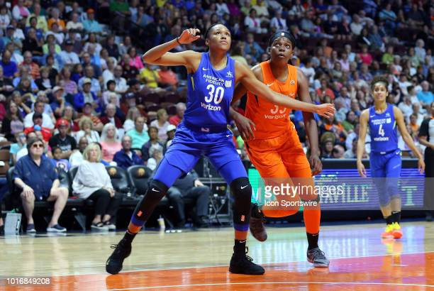 Dallas Wings forward Azura Stevens and Connecticut Sun forward Jonquel Jones in action during a WNBA game between Dallas Wings and Connecticut Sun on...