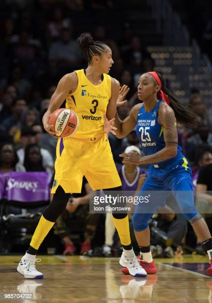 Dallas Wings forward Glory Johnson defends Los Angeles Sparks forward Candace Parker during the game between the Dallas Wings and the Los Angeles...
