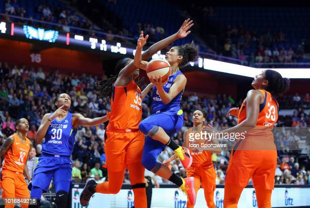 Dallas Wings guard Skylar DigginsSmith drives to the basket against Connecticut Sun forward Jonquel Jones during a WNBA game between Dallas Wings and...