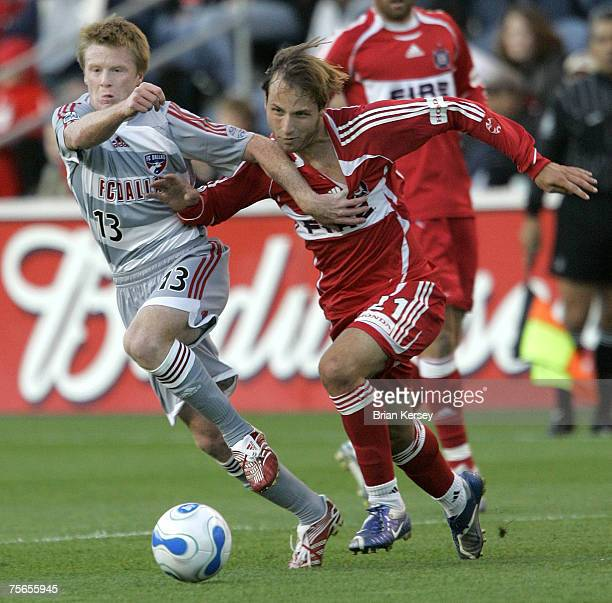 Dallas's Dax McCarty and Chicago Fire's Justin Mapp go for the ball during the first half of a soccer game at Toyota Park in Bridgeview, Ill. On...