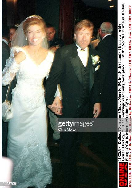 11/28/98 DallasTX Actor Chuck Norris holds the hand of his new bride Gena O''Kelley 35 The marriage ceremony took place at the North Church in Dallas