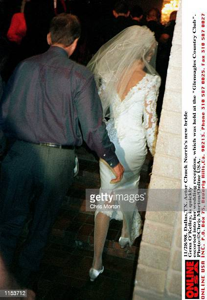 11/28/98 DallasTX Actor Chuck Norris's new bride Gena O''Kelley is quickly escorted into her wedding reception which was held at the Gleneagles...