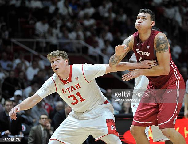 Dallin Bachynski of the Utah Utes and Jordan Railey of the Washington State Cougars tangle during their game at the Jon M Huntsman Center on January...