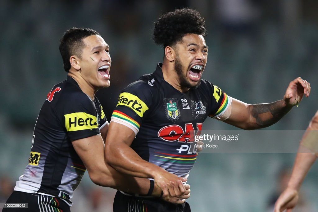 Dallin Watene Zelezniak and Waqa Blake of the Panthers celebrate Blake scoring a try during the NRL Semi Final match between the Cronulla Sharks and the Penrith Panthers at Allianz Stadium on September 14, 2018 in Sydney, Australia.