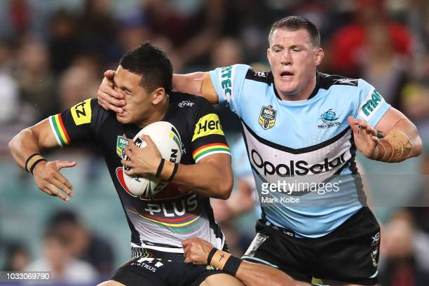Dallin Watene Zelezniak of the Panthers is tackled by Paul Gallen of the Sharks during the NRL Semi Final match between the Cronulla Sharks and the...