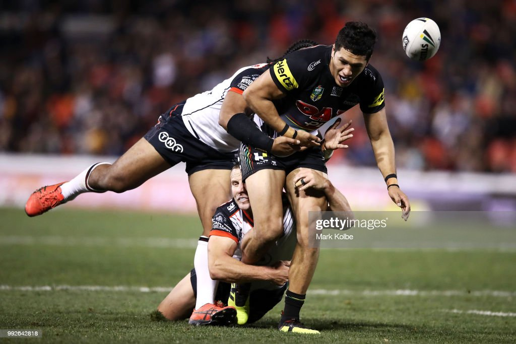 Dallin Watene Zelezniak of the Panthers is tackled during the round 17 NRL match between the Penrith Panthers and the New Zealand Warriors at Panthers Stadium on July 6, 2018 in Penrith, Australia.
