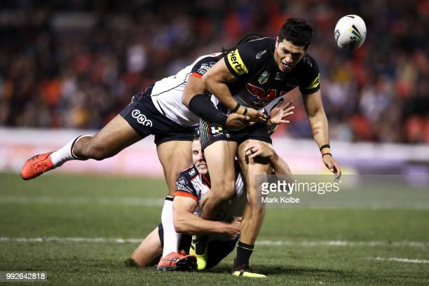 Dallin Watene Zelezniak of the Panthers is tackled during the round 17 NRL match between the Penrith Panthers and the New Zealand Warriors at...