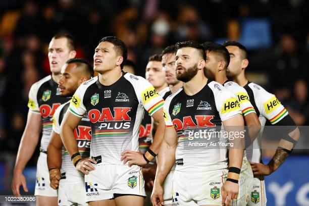 Dallin WateneZelezniak and Josh Mansour of the Panthers look on with the team during the round 24 NRL match between the New Zealand Warriors and the...