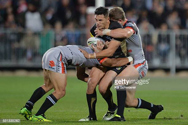 Dallin WateneZelezniak of the Panthers is tackled during the round 10 NRL match between the Penrith Panthers and the New Zealand Warriors at AMI...
