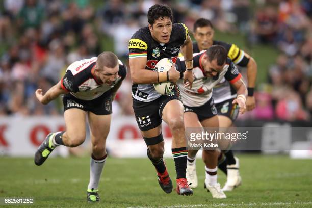 Dallin WateneZelezniak of the Panthers makes a break during the round 10 NRL match between the Penrith Panthers and the New Zealand Warriors at...