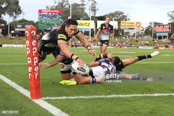 Dallin WateneZelezniak of the Panthers scores a try during the round four NRL match between the Penrith Panthers and the Newcastle Knights at Pepper...