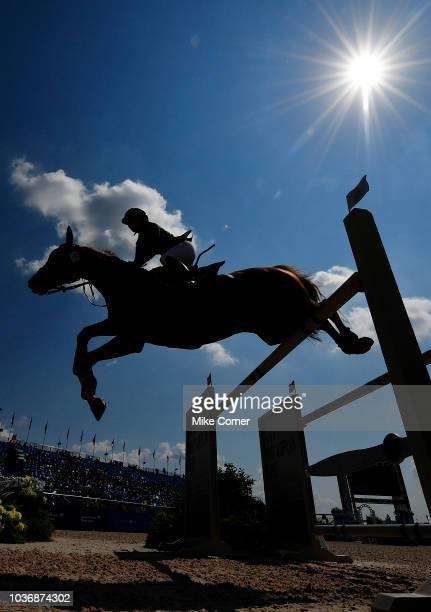 Dalma Malhas of Saudi Arabia jumps a gate on Toscanini Malpic during the Show Jumping competition at the FEI World Equestrian Games on September 20...