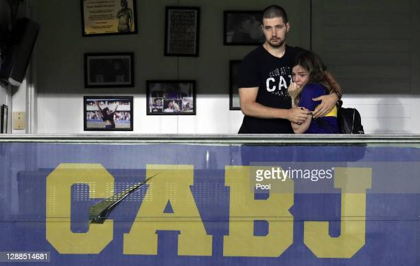 Dalma Maradona daughter of Diego Maradona cries next to her husband from her father's box as players of Boca Juniors pay tribute to the late football...