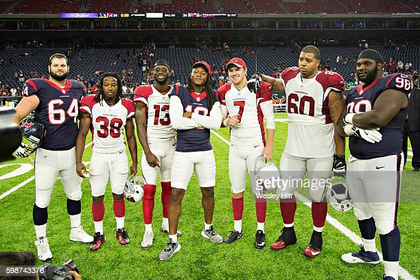 Dalton Freeman DeAndre Hopkins and DJ Reader of the Houston Texans and Andre Ellington Jaron Brown Chandler Catanzaro and Antoine McClain of the...