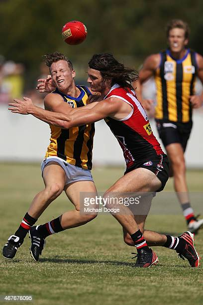 Dalton Graham is tackled by Dylan Roberton during a St Kilda Saints AFL intraclub match at Linen House Oval on February 8 2014 in Melbourne Australia