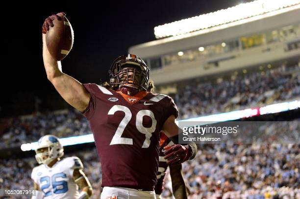 Dalton Keene of the Virginia Tech Hokies reacts after scoring the gamewinning touchdown against the North Carolina Tar Heels during their game at...