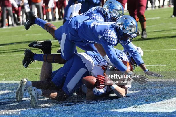 Dalton Keene of Virginia Tech catches a touchdown pass during the Belk Bowl college football game between the Virginia Tech Hokies and the Kentucky...