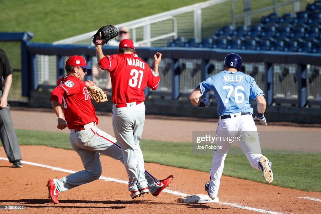 Dalton Kelly #76 of the Tampa Bay Rays gets to the first base bag ahead of Rhys Hoskins #70 of the Philadelphia Phillies on a play in the ninth inning of a Grapefruit League spring training game at Charlotte Sports Park on March 1, 2017 in Port Charlotte, Florida. The game ended in a 5-5 tie.