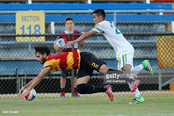 Dalton of the Fort Lauderdale Strikers is taken down by Jairo Arrieta of the New York Cosmos during first half action on June 4 2016 at Lockhart...