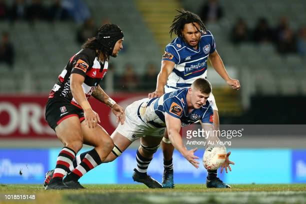 Dalton PapaliÕI of Auckland picks up a loose ball ahead of Latiume Fosita of Counties Manukau during the round one Mitre 10 Cup match between...