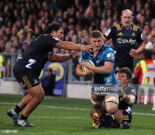 Dalton Papalii of the Blues is tackled during the round 10 Super Rugby match between the Highlanders and the Blues at Forsyth Barr Stadium on April...