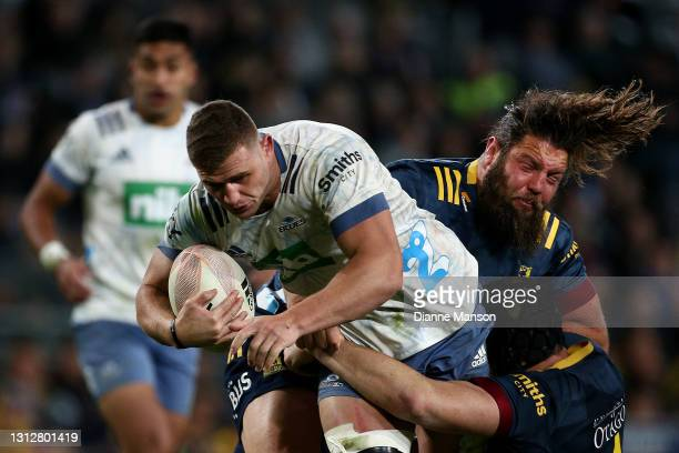 Dalton Paplii of the Blues is tackled by Josh Hohneck of the Highlanders during the round eight Super Rugby Aotearoa match between the Highlanders...