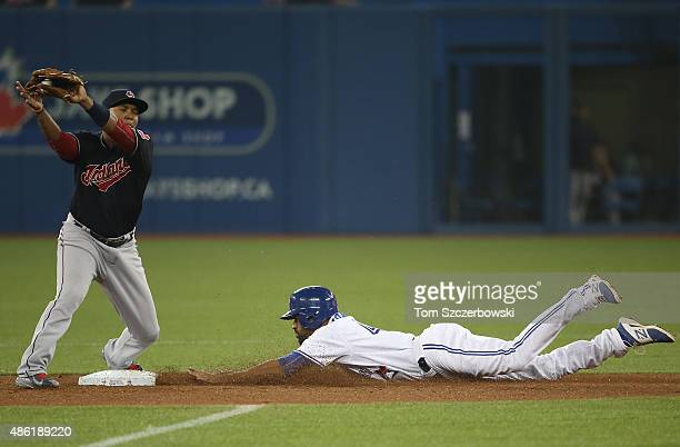 Dalton Pompey of the Toronto Blue Jays steals second base in the seventh inning during MLB game action as Jose Ramirez of the Cleveland Indians...